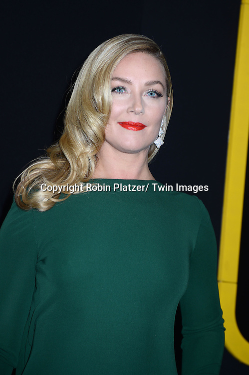 """Elisabeth Rohm in green Randi Rahm dress arrives at the World Premiere of """"American Hustle"""" on December 8, 2013 at The Ziegfeld Theatre in New York City."""