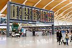 Departure board at Shanghai Pudong International Airport, China 2014