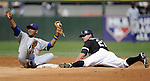 CHICAGO - JUNE 27:  Scott Podsednik #22 of the Chicago White Sox is tagged out by Andres Blanco #13 of the Chicago Cubs while trying to steal second base on June 27, 2009 at U.S. Cellular Field in Chicago, Illinois.  The White Sox defeated the Cubs 8-7.   (Photo by Ron Vesely)