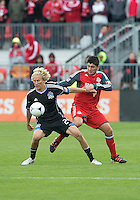 24 March 2012: San Jose Earthquakes forward Steven Lenhart #24 and Toronto FC defender Miguel Aceval #3 in action during a game between the San Jose Earthquakes and Toronto FC at BMO Field in Toronto..The San Jose Earthquakes won 3-0..
