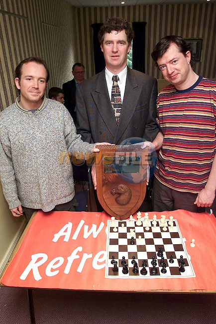 Michael O'Sullivan of Drogheda Concentrates presenting the Drogheda Chess Club Congress Shield to joint winners Daire McMahon and Ivan llorens..Picture Paul Mohan Newsfile