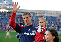 Chicago Fire forward Brian McBride (20) thanks the fans while circling the field with his daughters.  This game was McBride's last home game for the Fire.  The Chicago Fire tied DC United 0-0 at Toyota Park in Bridgeview, IL on Oct. 16, 2010.