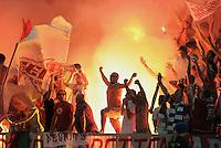 FUSSBALL   CHAMPIONS LEAGUE   SAISON 2011/2012  Qualifikation  23.08.2011 FC Zuerich - FC Bayern Muenchen Es Brennt in Zueri; FC Bayern Ultra -Fans feiern mit Bengalischen Feuer und Fahnen im Zuericher Lezigrund Stadion