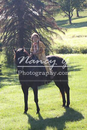 Native American Indian Lakota Sioux boy riding a black horse
