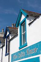 An island pub with the typical whitewashed stone walls and brightly painted window frames which can be seen in many of the houses on Islay
