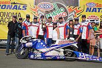 Jul. 28, 2013; Sonoma, CA, USA: NHRA pro stock motorcycle rider Hector Arana Jr celebrates with crew after winning the Sonoma Nationals at Sonoma Raceway. Mandatory Credit: Mark J. Rebilas-