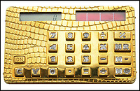 BNPS.co.uk (01202 558833)<br /> Pic: AdamPartridge/BNPS<br /> <br /> Kerching - bling, solid 18 ct gold and diamond calculator - Shoud be good for large amounts.<br /> <br /> An bespoke calculator made out of gold and diamonds has emerged for auction and is tipped to sell for &pound;15,000.<br /> <br /> The unique calculator is made of 18 carot gold which is made to look like crocodile skin, while its number keys are cut from a single diamond.<br /> <br /> The calculator - which measures 3.5in by 2in - is believed to have been made in London and was purchased in 1986.<br /> <br /> The vendor, who wishes to remain anonymous, says his father paid a five figure sum for the one-of-a-kind calculator which would be the envy of any banker 31 years ago.