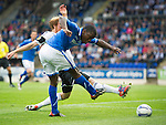St Johnstone v Rosenborg....25.07.13  Europa League Qualifier<br /> Nigel Hasselbainks shot is blocked by Per Ronning<br /> Picture by Graeme Hart.<br /> Copyright Perthshire Picture Agency<br /> Tel: 01738 623350  Mobile: 07990 594431