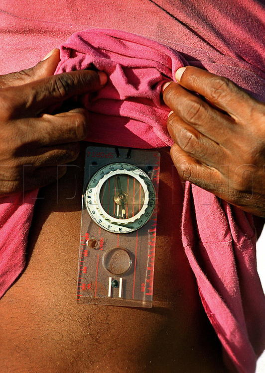 8/1994-Al Diaz/Miami Herald--In 1994 Cuban balseros turned the tiny fishing village of Cojimar into a major point of embarkation for thousands seeking a better life. Here, a Cuban rafter shows a compass hidden under his t-shirt before departing Cojimar, Cuba.