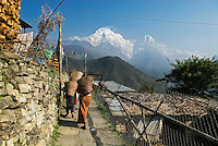 The village of Ghandruk in the Middle Hills of Nepal with the peak of Annupurna South in the background. Around every corner trekkers to this region experience another breathtaking view of village life set against the spectacular mountain backdrop.
