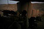 Soldiers from Alpha Battery 3-321 Field Artillery in Afghanistan's eastern Khost Province man Border Security Post 7 less than a mile from the Afghan-Pakistan border on Sunday Oct. 19, 2008.