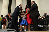 US President Barack Obama (C) greets Martin Luther King III (R), Arndrea Waters King (2-R) and their daughter Yolanda Renee King (bottom) at the conclusion of the 'Let Freedom Ring' commemoration event, at the Lincoln Memorial in Washington DC, USA, 28 August 2013. The event was held to commemorate the 50th anniversary of the 28 August 1963 March on Washington led by the late Dr. Martin Luther King Jr., where he famously gave his 'I Have a Dream' speech.<br /> Credit: Michael Reynolds / Pool via CNP