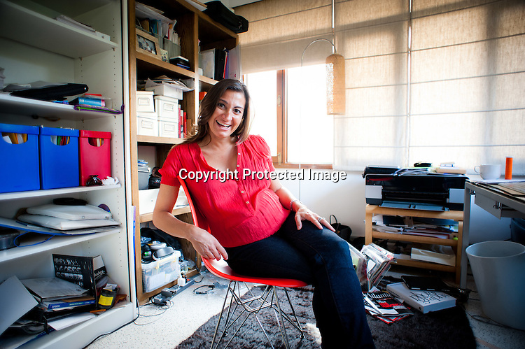 Award winning Photojournalist, Lynsey Addario share a light moment during the  portrait shoot in her home office in New Delhi, India. Photo: Sanjit Das