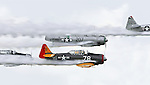 T-6/SNJ aircraft in formation with smoke on...