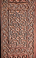 Fatehpur Sikri, Uttar Pradesh, India.   Hindu Swastikas and Floral Designs in Decoration Carved in Sandstone.   Birbal's Palace, Residence of the Emperor's Senior Wives.