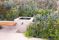 Mixing garden styles: Water garden feature in silver and blue color theme garden, patio, floating bench, lush flowering perennial bed: Achillea, Astelia, fence, for sleek sophistical style mixed with romantic cottage style