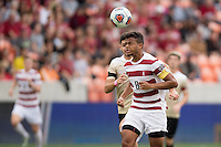 Houston, TX -  Sunday, December 11, 2016: Brian Nana-Sinkam (8) of the Stanford Cardinal heads the ball towards the Wake Forest Demon Deacons goal in the first half of the  NCAA Men's Soccer Finals at BBVA Compass Stadium.