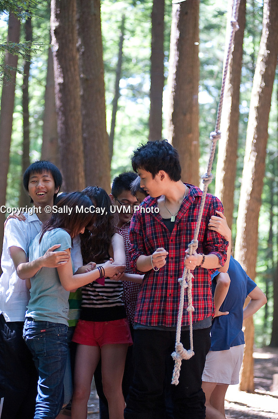 US-Sino Pathway Program students navigate the UVM Adventure Ropes Course.  USPP