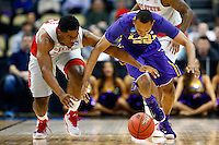 PITTSBURGH, PA - MARCH 19:  Tim Quarterman #55 of the LSU Tigers fights for the ball against Lennard Freeman #10 of the North Carolina State Wolfpack in the first half during the second round of the 2015 NCAA Men's Basketball Tournament at Consol Energy Center on March 19, 2015 in Pittsburgh, Pennsylvania.  (Photo by Jared Wickerham/Getty Images)