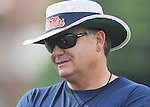 Coach Houston Nutt talks to a player as the University of Mississippi began football practice in Oxford, Miss. on Saturday, August 6, 2011. The team began practicing outside before lightning in the area sent them indoors for practice. (AP Photo/Oxford Eagle, Bruce Newman)