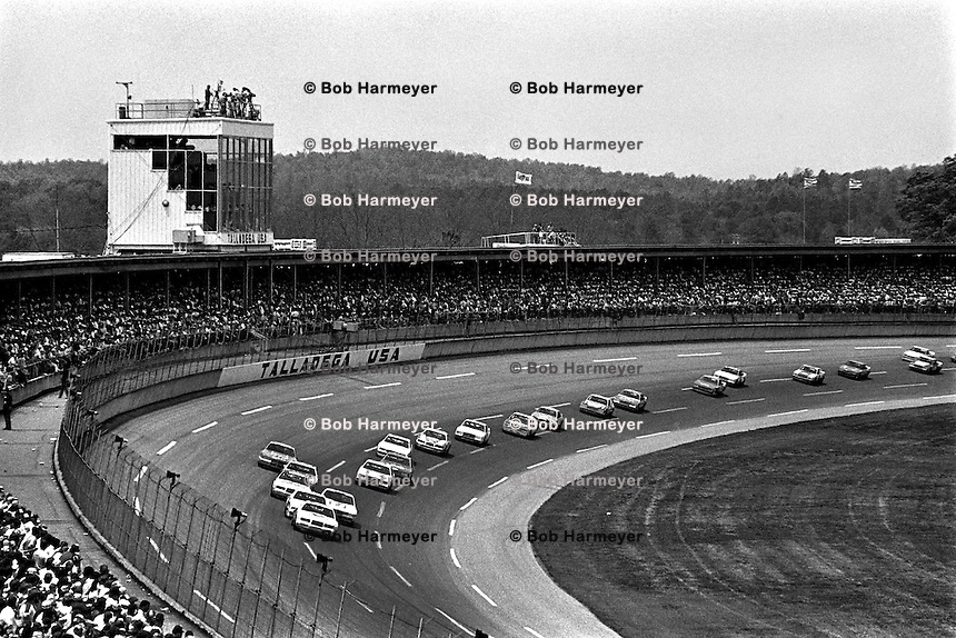 TALLADEGA, AL - MAY 1: Buddy Baker, driving the Wood Brothers Ford, leads a group of cars through the tri-oval during the Winston 500 NASCAR Winston Cup race at the Talladega Superspeedway near Talladega, Alabama, on May 1, 1983.