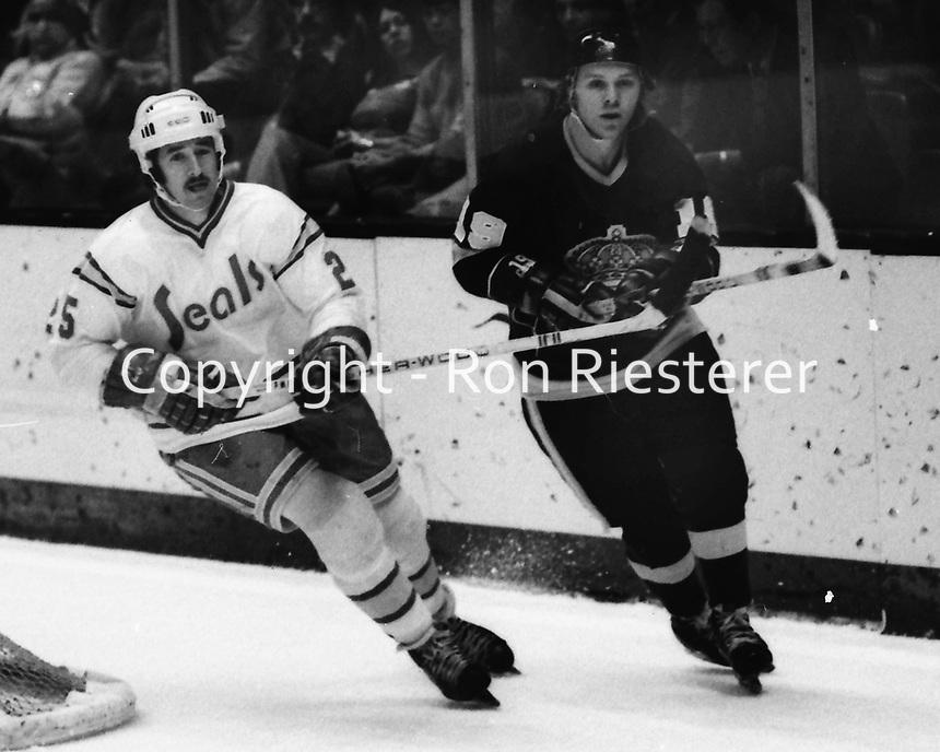 Seals vs LA Kings, Al MacAdam, and Kings Butch Goring. (1975 photo/Ron Riesterer)