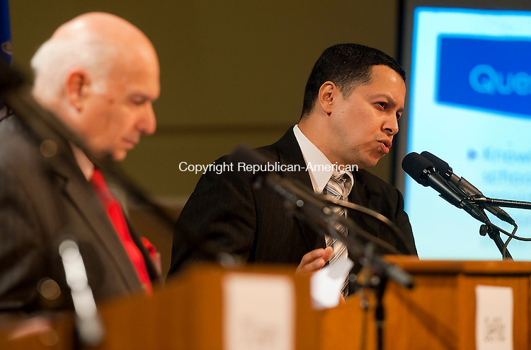 WATERBURY, CT--- -102115JS24--Mayoral Republican candidate Jose Morales, right, answers a question as Independent Lawrence De Pillo waits his turn during a debate on education Wednesday at Waterbury Arts Magnet School. <br /> Jim Shannon Republican-American