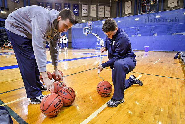 March 15, 2017; Men's Basketball student managers inflate basketballs for practice at the University at Buffalo prior to the 2017 NCAA Tournament. (Photo by Matt Cashore/University of Notre Dame)