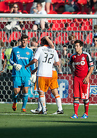 28 July 2012: Houston Dynamo defender Bobby Boswell #32,Houston Dynamo defender Andre Hainault #31 and Houston Dynamo goalkeeper Tally Hall #1 celebrate the win during an MLS game between Toronto FC and the Houston Dynamo at BMO Field in Toronto,Ontario Canada..The Houston Dynamo won 2-0...
