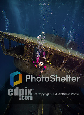 10 June 2014: SCUBA Diver Sally Herschorn explores the wreck of the USS Kittiwake, a former United States Navy submarine rescue vessel, off Seven Mile Beach, on the West Shore of Grand Cayman Island. Purchased by the government of the Cayman Islands, the Kittiwake was intentionally sunk on January 5, 2011, to create an artificial reef in the Cayman Marine Park. Located in the British West Indies in the Caribbean, the Cayman Islands are renowned for excellent scuba diving, snorkeling, beaches and banking.  Mandatory Credit: Ed Wolfstein Photo *** RAW (NEF) Image File Available ***