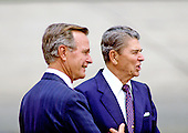 United States Vice President George H.W. Bush, left, arrives at the 1988 Republican National Convention in New Orleans, Louisiana as U.S. President Ronald Reagan, right, departs on August 16, 1988..Credit: Arnie Sachs / CNP