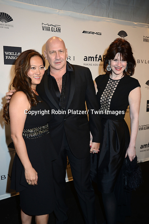 Carmen Marc Valvo and guests attends the amfAR New York Gala on February 5, 2014 at Cipriani Wall Street in New York City.