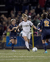 """Boston College forward Kristen Mewis (19) passes the ball. Boston College defeated West Virginia, 4-0, in NCAA tournament """"Sweet 16"""" match at Newton Soccer Field, Newton, MA."""