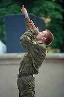 Saint Petersburg, Russia, 27/07/002..The mid-summer White Nights period when the sun sets only briefly is a time of festivals & entertainment. A drunk soldier cheers a rock group at the Neva Delta Blues festival in a city centre park...