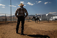 """Wild horses are gentled at the Warm Springs Correctional Center, a minimum security prison.  Hank Curry has run the horse training program for more than 5 years.  He has selected 500 horses, only 5 had to be returned.  Many have been adopted and are ridden.  The horses and inmates learn life lessons.  Horses learn from repetition and adjust to new things. As Hank says, """"It's about as exciting as watching paint dry.  We bore them into submission."""""""