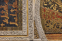 Detail from the mihrab portal, a horseshoe arch and rectangular surround or alfiz richly decorated with tesserae (glass mosaic with gold or coloured backing) with vegetal designs and kufic inscriptions, in the Cathedral-Great Mosque of Cordoba, in Cordoba, Andalusia, Southern Spain. The first church built here by the Visigoths in the 7th century was split in half by the Moors, becoming half church, half mosque. In 784, the Great Mosque of Cordoba was begun in its place and developed over 200 years, but in 1236 it was converted into a catholic church, with a Renaissance cathedral nave built in the 16th century. The historic centre of Cordoba is listed as a UNESCO World Heritage Site. Picture by Manuel Cohen