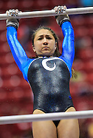 Columbus North freshman Katrina May competes on the uneven bars during the IHSAA gymnastics state finals meet at Worthen Arena in Muncie, Indiana. (Michael Hickey | For The Republic)