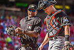 28 September 2014: MLB Umpire Alan Porter chats with catcher Jacob Realmuto during a game between the Miami Marlins and the Washington Nationals at Nationals Park in Washington, DC. The Nationals shut out the Marlins with a 1-0 no-hitter going to Nationals pitcher Jordan Zimmermann in the last game of the regular season. Mandatory Credit: Ed Wolfstein Photo *** RAW (NEF) Image File Available ***