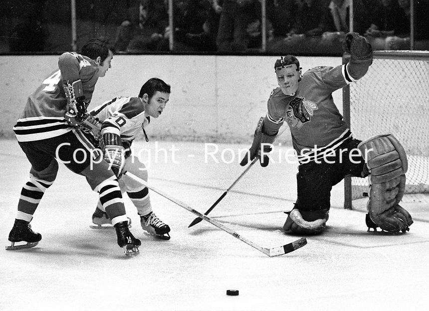 Seals Ernie Hicke tries to score on Chicago Blackhawks goalie Ken Brown and #4 Doug Jarrett. (1970 photo/Ron Riesterer)