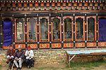 Asia, Bhutan, Thimpu. Three men sit on a bench at The Memorial Chorten in Thimpu.
