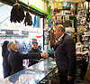 Sadiq Khan <br /> Labour mayor of London candidate and Chuka  Umunna MP for Brixton &amp; Streatham walk around Brixton canvassing locals to support Labour in the forthcoming 5th May election.<br /> <br /> Sadiq Khan <br /> visits a local trader <br /> <br /> Photograph by Elliott Franks <br /> Image licensed to Elliott Franks Photography Services