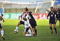 Lauren Cheney gets dragged down by a German defender.  The USA captured the 2010 Algarve Cup title by defeating Germany 3-2, at Estadio Algarve on March 3, 2010.