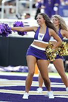 2013-09-21: Washington cheerleader Kaylie Gray entertained fans during the game  against Idaho State.  Washington won 56-0 over Idaho State in Seattle, WA.
