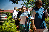 Dr. Vandana Shiva (center) shares a laugh with the Minister of Environment, Sr. Jairam Ramesh (right), as they walk through the Navdanya grounds in Dehradun, Uttarakhand, India, on 6th September 2009...Dr. Vandana Shiva, the founder of Navdanya Foundation and Bijavidyapeeth, is a physicist turned environmentalist who campaigns against genetically modified food and teaches farmers to rely on indigenous farming methods.. .Photo by Suzanne Lee / For The National