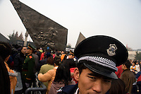 "Police officers control the crowd as visitors flock into the grounds of the Memorial Hall of the Nanjing Massacre in Nanjing, China, on Thursday, Dec. 13, 2007.  After two years of renovations, the Memorial Hall of the Nanjing Massacre reopened to the public on Dec. 13, 2007, the 70th anniversary of the 6-week massacre by Japanese troops that started Dec. 13, 1937 and claimed more than 300,000 lives.  The commemoration comes amid renewed controversy about the accuracy of historical accounts of the massacre.  The massacre is also known as ""The Rape of Nanking."""