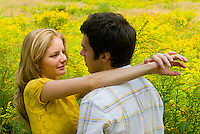 Couple posing in front of goldenrod