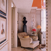 A velvet-upholstered armchair in the guest room stands beside a basalt bust of George Washington