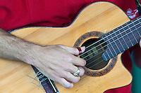 Cuba, Cienfuegos.  Fingers Plucking Strings on a Guitar.