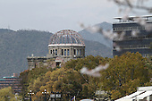 Apr. 05, 2010; Hiroshima, Japan - Springtime in Hiroshima. A view of the Genbaku Dome with cherry blossom trees in full bloom in Peace Park.