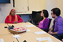 Bisharo Kasim, a Somali Bantu and interpreter, (in red sweater) meets with medical students KAtia Chavez and Nicholas Monte.